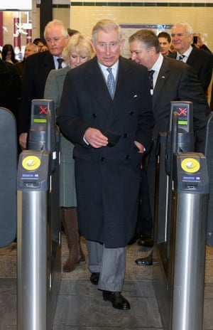Prince Charles and Camilla, Duchess of Cornwall walk through a ticket gate as they prepare to travel on a Metropolitan underground train from Farringdon to Kings Cross as they mark 150 years of London Underground.