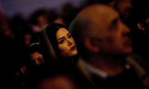 An Iranian Zoroastrian watches a performance during the annual Zoroastrian Sadeh festival in Tehran. Sadeh, is an ancient Persian festival that is celebrated by setting a huge bonfire to honour fire and to defeat the forces of darkness, frost, and cold.