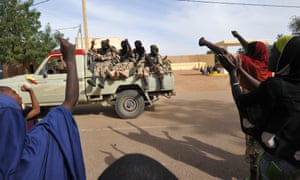 People cheer as Malian soldiers enter the town of Ansongo that was recaptured by French-led soldiers over the weekend.