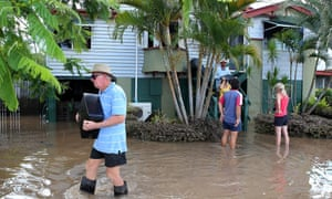 Residents collect belongings from their homes as parts of southern Queensland, Australia, experiences record flooding in the wake of Tropical Cyclone Oswald. Flood waters peaked at 9.53 metres  and four deaths have been confirmed so far.