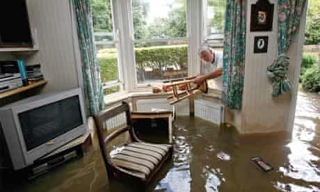 Householder recovers furniture from his flooded home