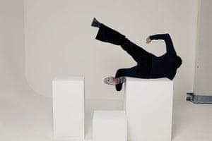 Noel Fielding - Glam: Noel Fielding falling off white blocks