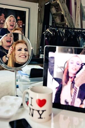 Noel Fielding - Glam: Noel Fielding laughing in mirror wearing wig