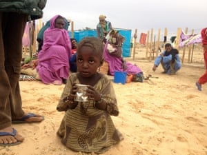 A young Malian, who fled the violence in the historic city of Timbuktu, carries a cup in a refugee camp in the Mauritanian town of Fassala. France is entering the final phase of its military intervention in Mali after a lightning advance that quickly exposed the weakness of Islamist rebels holding the country's north.