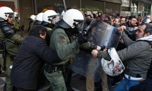 Protesters clash with riot police outside the Labor Ministry in the center of Athens. Protesters from a Communist-back labor union forced their way into a government building and clashed with police who used tear gas to expel them.