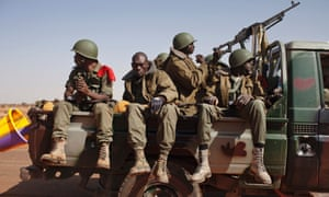 Malian soldiers arrive in the recently liberated town of Douentza. French troops took control of the airport today which was the last urban stronghold held by Islamist rebels,.