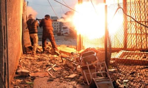 A Free Syrian Army fighter fires a rocket propelled grenade during heavy fighting in the Ain Tarma neighbourhood of Damascus.