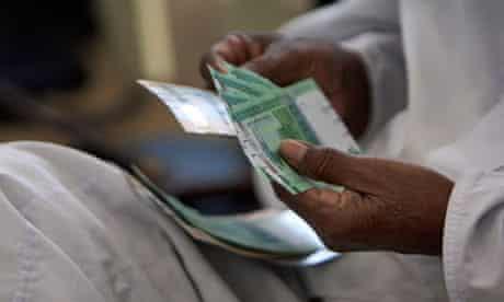 Counting money in Khartoum