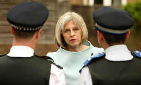Theresa May with police