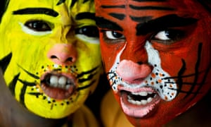 Indian School children with faces painted like tigers take part in the 'Save our Tiger' campaign, in Southern Indian city of Bangalore