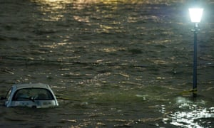 A car is tied to a lamp post like a boat during floods in Hamburg, Germany. Stormy weather caused the River Elbe to burst its banks.