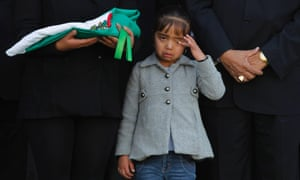 A very sad scene as the daughter of Eusebio Gonzalez, a policeman who was shot dead on Tuesday while trying to stop a group of criminals, cries during a tribute to her father in Ecatepec, Mexico.