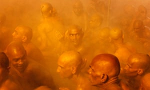 Hindu holy men of the Juna Akhara sect participate in a ritual that is believed to rid them of all ties in this life and dedicate themselves to serving God as a 'Naga' or naked holy man during the Maha Kumbh festival in Allahabad, India.