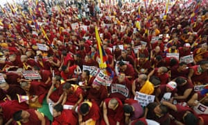 Thousands of Tibetans people and monks gathered at Rajghat Mahatma Gandhi memorial in Indian capital