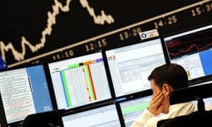 Stock broker at screens