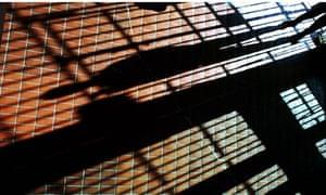 Prison bars cast shadows across the floor