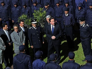 Prime Minister David Cameron takes part in a graduation ceremony for Police Officers with Libya's Interior Minister Ashour Shuail as part of his visit in Tripoli.