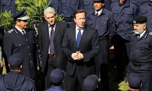 Prime Minister David Cameron takes part in a graduation ceremony for Police Officers in Tripoli