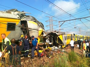 Rescuers work at the site of a train accident near Kalefong station, Attridgeville, to the west of Pretoria in South Africa. The collision between two passenger trains packed with school children and rush-hour commuters that injured up to 300 people has being blamed on cable theft, the authorities said.