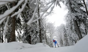 An athlete takes part in a training session for the FIS Cross Country skiing World Cup at Laura Cross Country and Biathlon Center in the Russian Black Sea resort of Sochi.