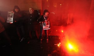 Demonstrators shout and burn flares in central Moscow, during an unauthorized protest rally of opposition activists to defend Article 31 of the Russian constitution which guarantees freedom of assembly.