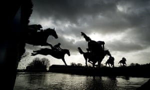 A moody view of Wincanton racecourse as runners take the water jump in the Elite Racing Club novices' limited handicap steeple chase.