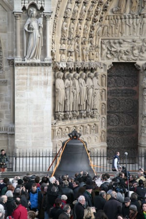The bell, the bell! People gather as a bell arrives at Paris' Notre Dame Cathedral, in Paris. This bell, the biggest among nine new ones, has been made in the Dutch Royal Eijbouts foundry in Asten. Baptised Marie, the bell weigh 6 tons and plays a G sharp note.