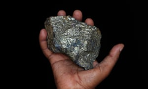 A mine employee shows a piece of copper ore at the Kilembe mines, in the foothills of the Rwenzori Mountains, about 309 miles west of Uganda's capital Kampala. The Kilembe copper-cobalt mine operated from 1956 to 1972, when it closed due to a drop in world copper prices and now lays in ruins. Uganda's President Yoweri Museveni has promised to rehabilitate the Kilembe mines.