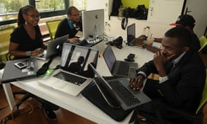 Juliana Rotich, 35, executive director of Ushahidi, sits with colleagues in their offices in Nairobi