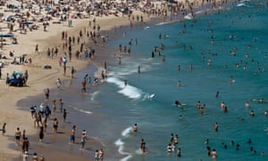 Sydneysiders and tourists flock to the popular Bondi beach in Sydney, Australia, during the on-going heatwave. Photograph: Manan Vatsyayana/AFP/Getty Images