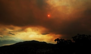 Clouds from a nearby bushfire are seen over Mount Wellington as bushfires burn across Tasmania, South Australia and Victoria as temperatures soar.