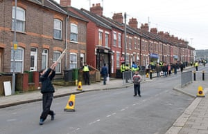 luton v wolves: Children play cricket in the street in Luton