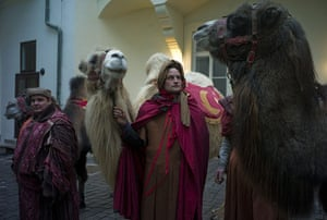 Epiphany Day: A man holds a camel before a traditional march in Prague