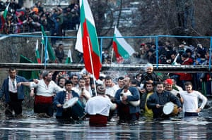 Epiphany Day: Bulgarian men dance in the icy waters of the Tundzha river