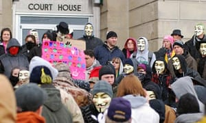 Activists from Anonymous rally at the Jefferson County Courthouse in Steubenville, Ohio