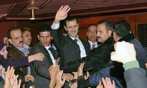 Bashar al-Assad waves to his supporters after speaking at the Opera House in Damascus on 6 January 2013.
