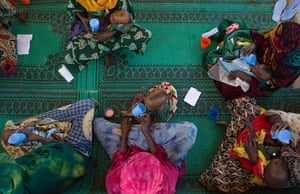 Chad Stunted Nation:  mothers feed their malnourished children at a nutritional health clinic