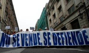 National health workers march during the first major demonstration of the year, in Madrid Monday Jan. 7, 2013.