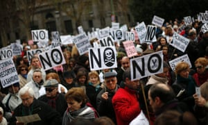 Health workers and supporters take part in a protest against the local government's plans to cut public healthcare spending in Madrid January 7, 2013.