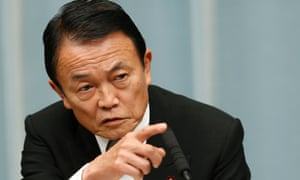 Japan's Finance Minister Taro Aso speaks at a news conference in Tokyo December 27, 2012.