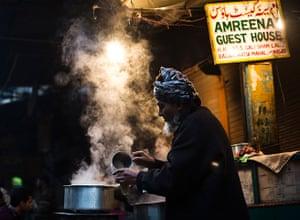 Cold weather in India: A vendor prepares tea at his roadside tea stall