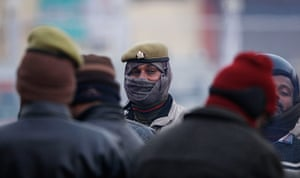 Cold weather in India: Policemen, wrapped up against the cold, stand guard at the Sangam