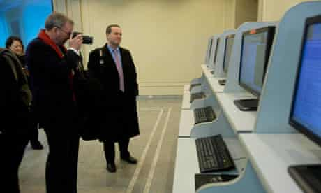 Eric Schmidt takes photographs as he tours a computer lab at Kim Il-sung university in Pyongyang