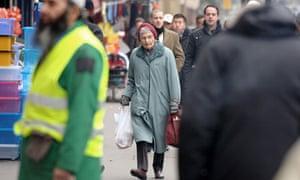 Older woman walking down a street