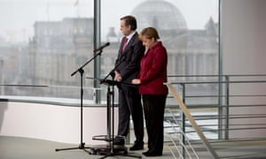 German chancellor Angela Merkel (right) and Greek prime minister Antonis Samaras give statements to the media.