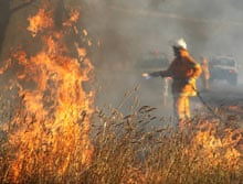 Firefighters tackle a grass fire in Gunning, New South Wales.