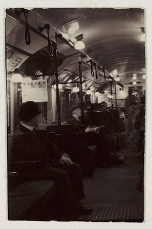 Tube through the decades: Interior of an underground train carriage, London, c 1930