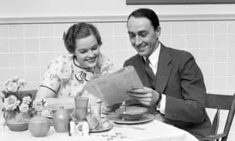 Couple At Breakfast Table Reading Newspaper
