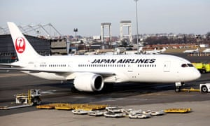 A Japan Airlines Boeing 787 Dreamliner is towed back to the gate after a fuel leak