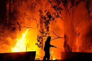 Wildfires Australia: A firefighter is almost surrounded by flames